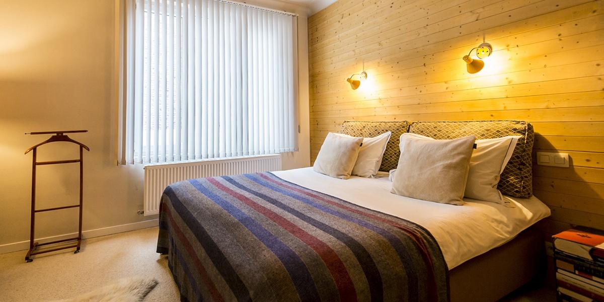 gezellig opgemaakt bed van de cosy suite van aplace / antwerp