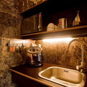 kitchen with coffee maker and sink in the square view suite of aplace antwerp